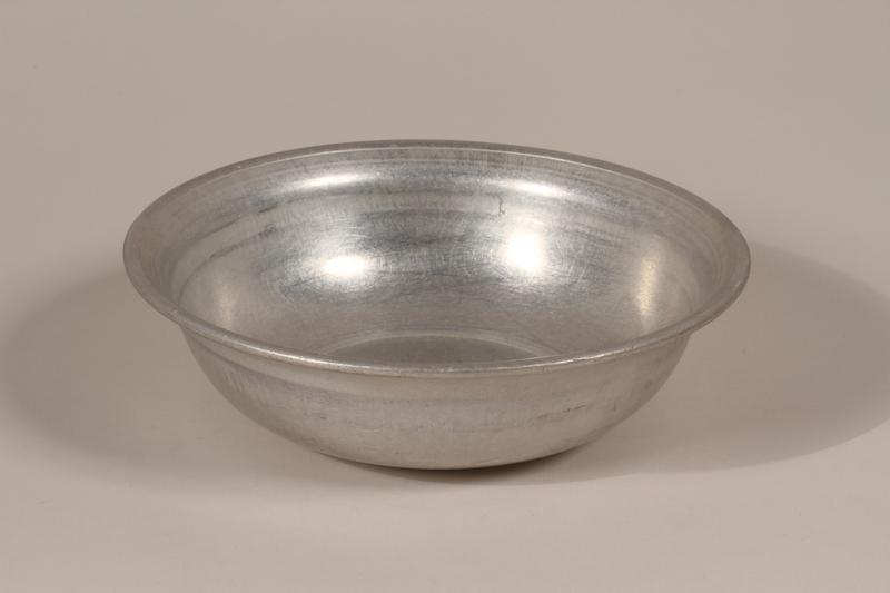 1990.36.26 front Metal basin