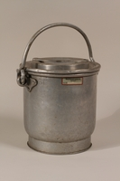 1990.36.27 front Food carrier with lid  Click to enlarge