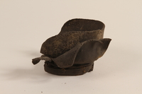1990.37.17 front Shoe fragment  Click to enlarge