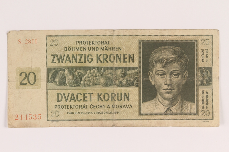 2009.263.16 front German occupation currency note, 20 kronen,  issued in the Protectorate of Bohemia and Moravia