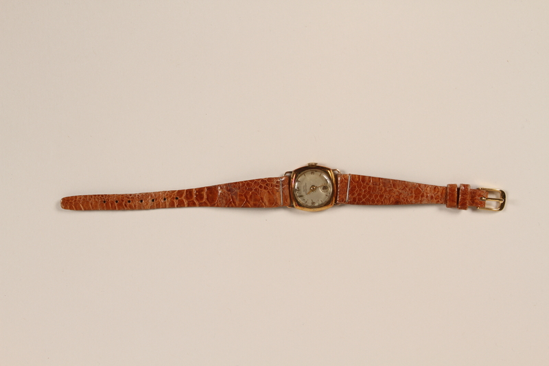2009.360.1 front Woman's gold wrist watch kept with a Jewish concentration camp inmate