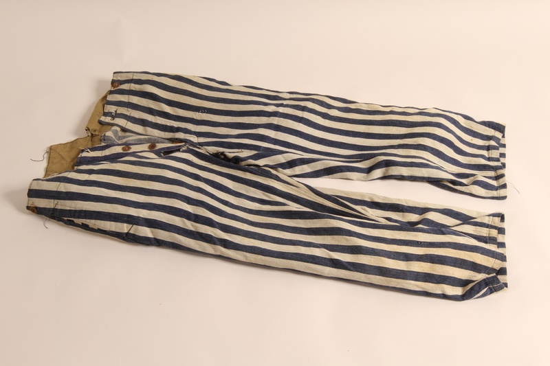 2011.449.1 front Concentration camp uniform pants worn by a Hungarian Jewish prisoner