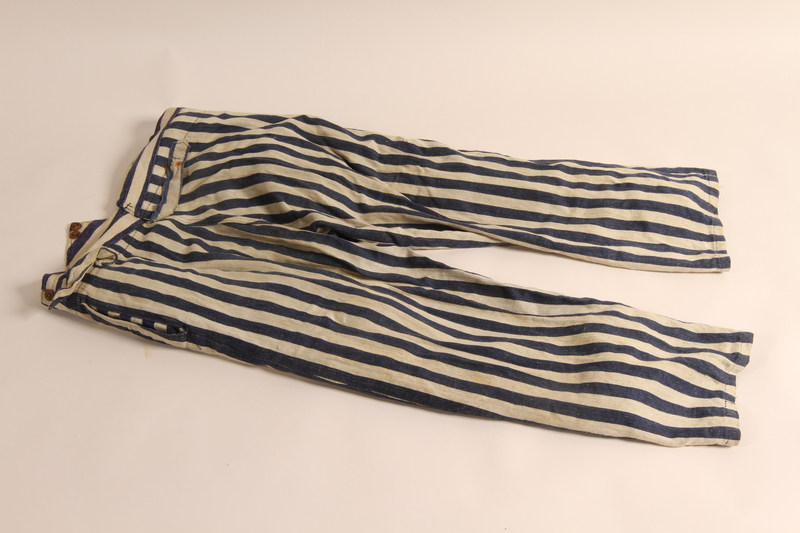 2011.449.1 back Concentration camp uniform pants worn by a Hungarian Jewish prisoner