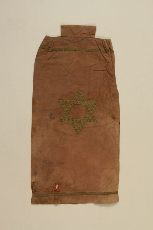 1990.41.20 front Brown cloth Torah mantle with a Star of David applique