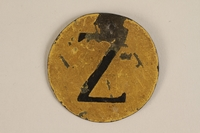 1988.27.4 front Yellow metal badge with Croatian Z for Jew worn by a Sephardic Jew  Click to enlarge
