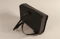 1990.44.1 back Black leather covered fiberboard knapsack used by a student in Nazi Germany  Click to enlarge
