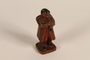 Figurine of a man in folk costume playing a clarinet brought to the US by a Jewish refugee from prewar Germany