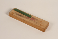 1990.44.3 bottom Wooden sliding lid pencil box with a rose decal used by a student in Nazi Germany  Click to enlarge