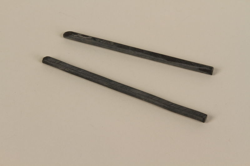 1990.44.5 front Gray slate writing instruments used by a student in Nazi Germany
