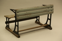 1990.44.7 3/4 view Slatted wooden desk with attached bench on wrought iron supports used in a Dresden schoolroom in Nazi Germany  Click to enlarge