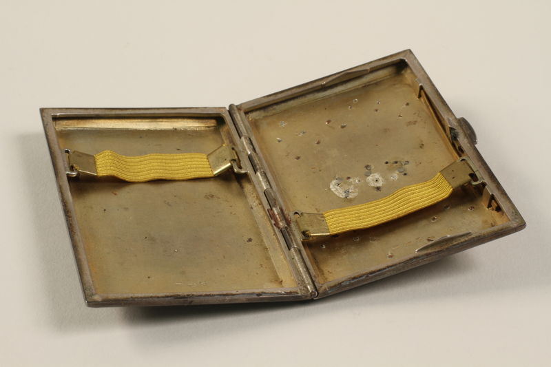 2009.352.2 open Engraved silver cigarette case used by a Polish Jewish refugee in Russia