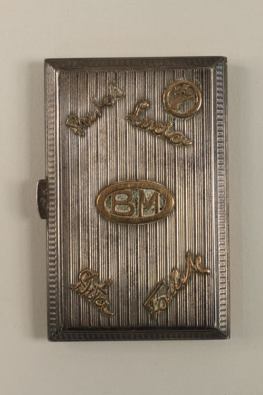 2009.352.2 front Engraved silver cigarette case used by a Polish Jewish refugee in Russia