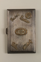 2009.352.2 front Engraved silver cigarette case used by a Polish Jewish refugee in Russia  Click to enlarge