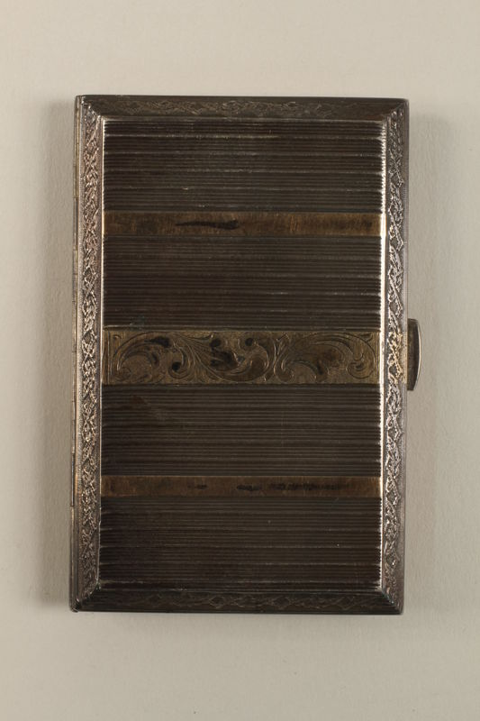 2009.352.2 back Engraved silver cigarette case used by a Polish Jewish refugee in Russia