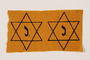Two unused Star of David badges with a J issued to a Jewish family