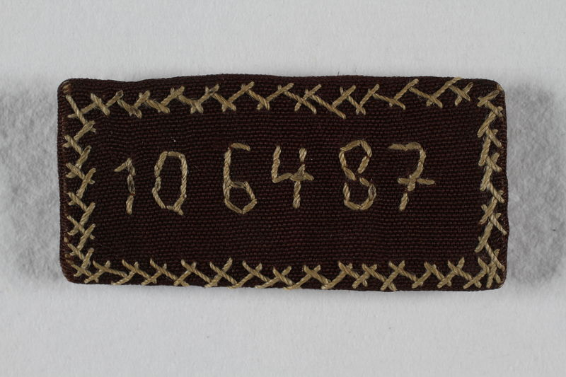 2009.359.1 front Handmade pin embroidered with her prisoner number made for a concentration camp inmate on her 16th birthday