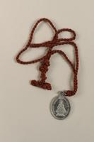 2009.359.2 front L'Enfant Jesus Miraculeux de Prague [Miraculous Infant Jesus of Prague] medallion given to an young Austrian Jewish woman  Click to enlarge