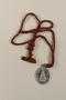 L'Enfant Jesus Miraculeux de Prague [Miraculous Infant Jesus of Prague] medallion given to an young Austrian Jewish woman