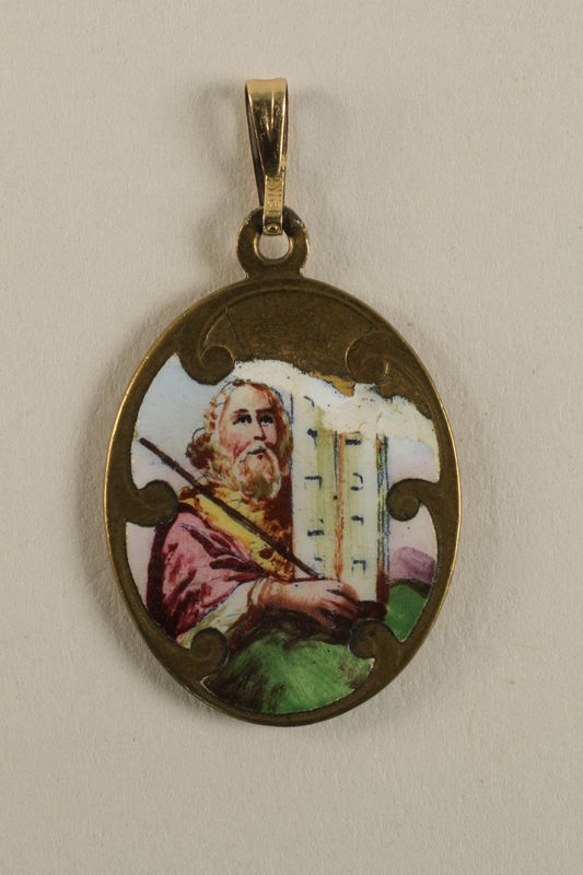 2009.359.3 front Medallion with Moses and the S'hma prayer found by a young Jewish woman on a camp transport