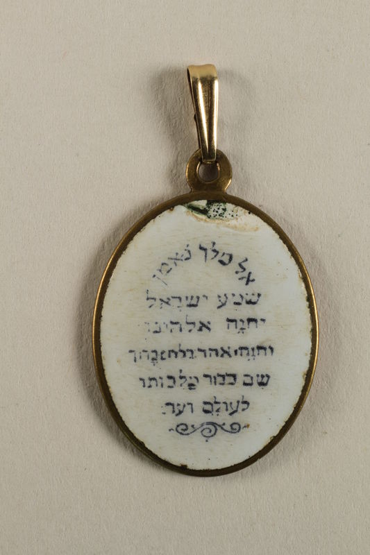 2009.359.3 back Medallion with Moses and the S'hma prayer found by a young Jewish woman on a camp transport