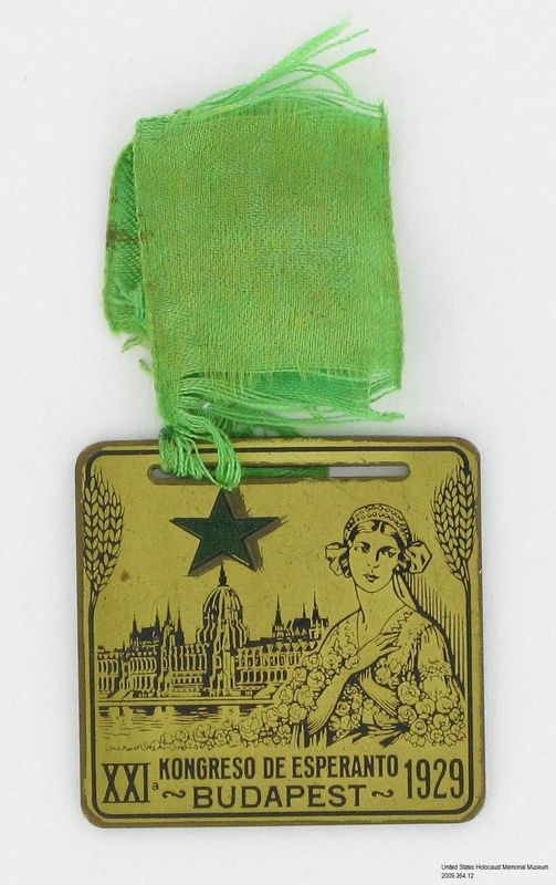 2009.364.12, medal from an Esperanto conference, with a woman and a view of Budapest, Tom T. Kovary Collection World Congress of Esperanto medallion with an image of woman and a view of Budapest owned by a Czech Jewish refugee