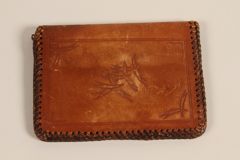 2009.364.13 front Brown leather wallet with laced edges used by a Czech Jewish refugee during his service in the US Army