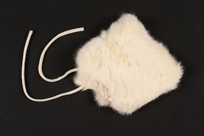 2009.372.3 front Child's white rabbit fur bonnet received in a displaced persons camp