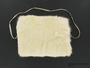 Child's white rabbit fur hand muff received in a displaced persons camp