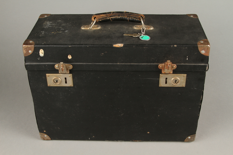 2009.372.5 c front Leitz glass slide projector with case, trays, and key ring used in a displaced persons camp