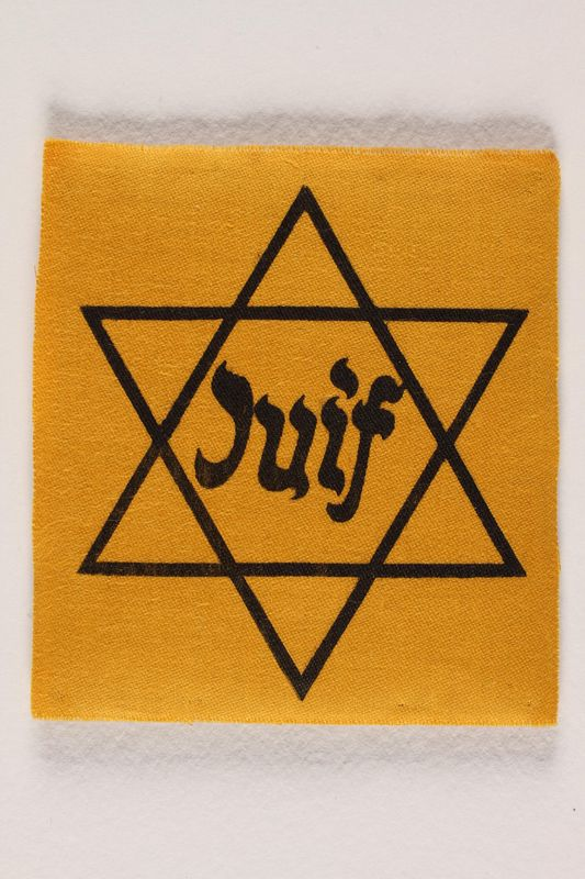 1990.54.1 front Unused Star of David badge with Juif acquired by a Jewish chaplain, US Army