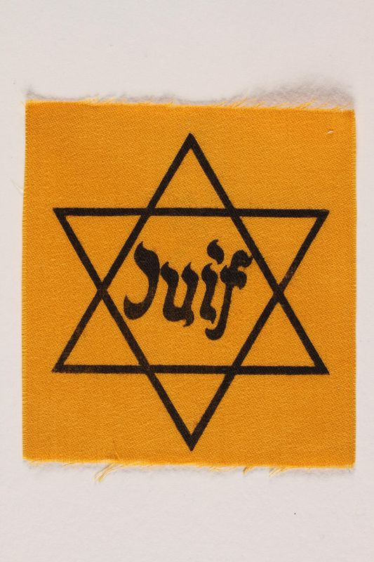 1990.54.3 front Unused Star of David badge with Juif acquired by a Jewish chaplain, US Army