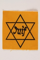 1990.54.3 front Unused Star of David badge with Juif acquired by a Jewish chaplain, US Army  Click to enlarge
