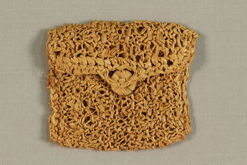 1990.57.1 front Straw purse with crocheted  trim acquired in Gurs internment camp by a German Jewish prisoner