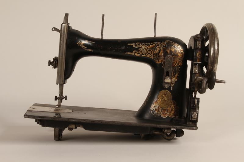 1990.78.1 front Singer style treadle sewing machine table of the type used in Łódź Ghetto