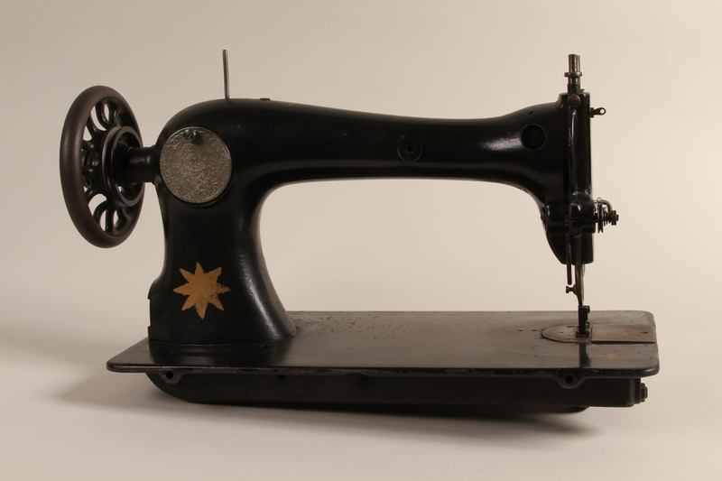 1990.78.4 front Treadle sewing machine with painted star of the type used in Łódź Ghetto