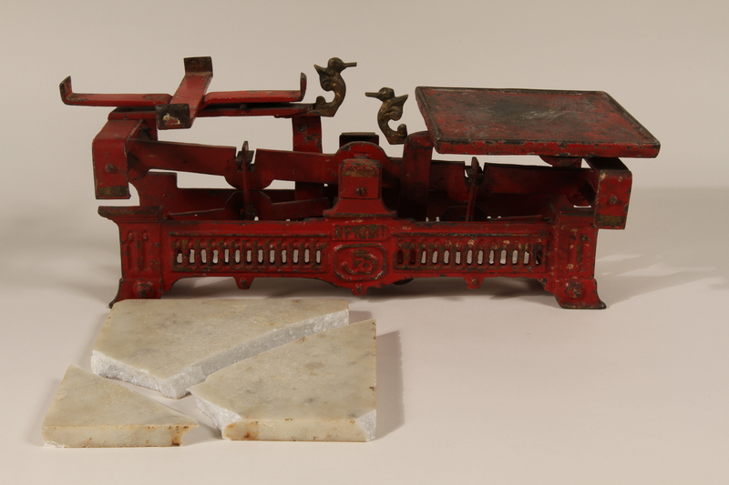 1990.80.1 a-c open Red metal butcher scale with marble weight