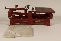 1990.80.1 a-c open Red metal butcher scale with marble weight  Click to enlarge