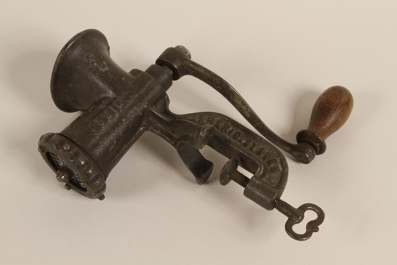 1990.81.6 front Manual hand crank meat grinder