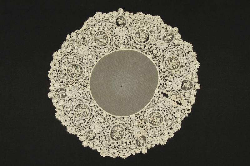 2009.376.41 front Doily with floral lace border brought to the US by a Jewish family fleeing German occupied Poland