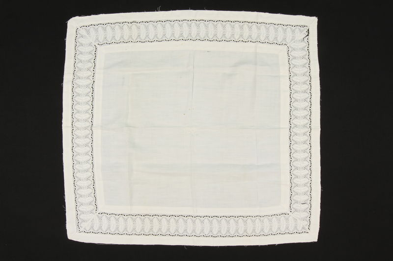 2009.376.42 front White square cotton pillowcase with a cutwork border brought to the US by a Jewish family fleeing German occupied Poland