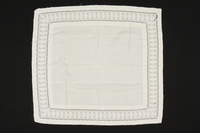 2009.376.42 front White square cotton pillowcase with a cutwork border brought to the US by a Jewish family fleeing German occupied Poland  Click to enlarge