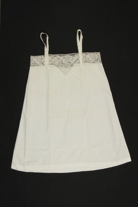 2009.376.7 front White embroidered fine cotton slip with lace inlay brought to the US by a Jewish family fleeing German occupied Poland