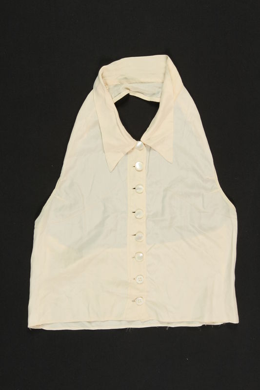 2009.376.3 front Woman's white silk dickey brought to the US by a Jewish family fleeing German occupied Poland