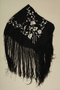 Fringed black silk piano shawl with embroidered silver flowers brought to the US by a Jewish family fleeing German occupied Poland
