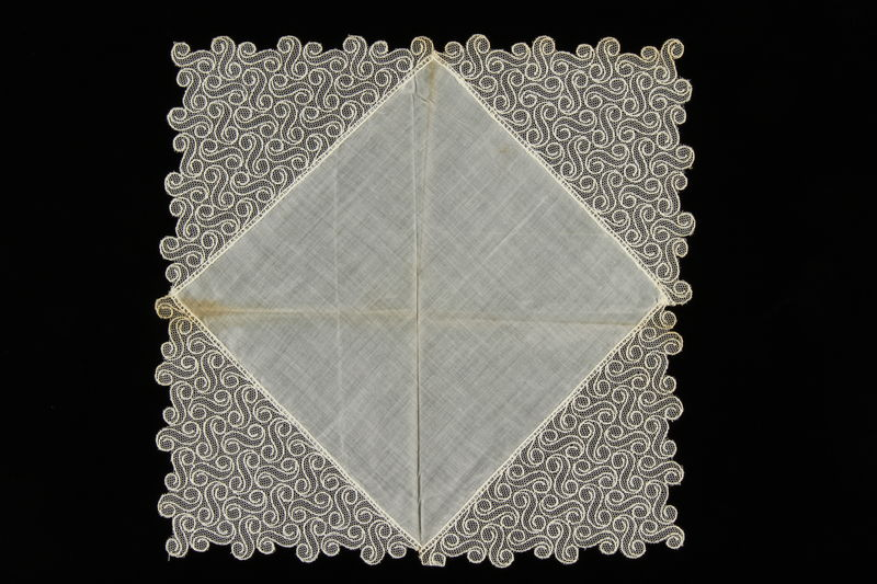 2009.376.32 front Lace bordered white handkerchief brought to the US by a Jewish family fleeing German occupied Poland