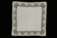 2009.376.33 front White handkerchief with an embroidered triangle patterned border brought to the US by a Jewish family fleeing German occupied Poland  Click to enlarge