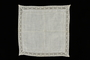 White cotton lace handkerchief with a floral motif lace border brought to the US by a Jewish family fleeing German occupied Poland