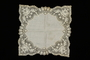 White silk handkerchief with handmade floral lace design brought to the US by a Jewish family fleeing German occupied Poland