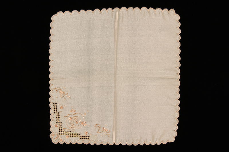 2009.376.39 front Peach silk handkerchief hand embroidered with ribbons and flowers brought to the US by a Jewish family fleeing German occupied Poland