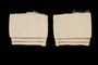 Two white silk sleeve cuffs with stitched whitework borders brought to the US by a Jewish family fleeing German occupied Poland